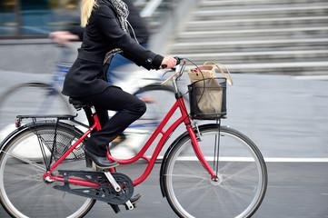 Fototapete - Woman on bike in profile