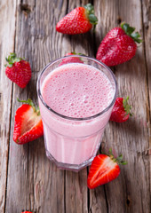 Fresh milk,strawberry drink on wooden table, assorted protein co