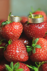 beautiful Wedding rings for groom and bride with strawberry