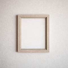 White wooden frame on white wall