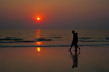 Sunset couple beach