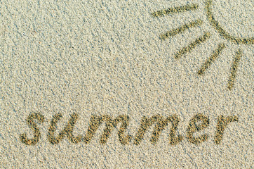 "Word ""Summer"" and sun drawn on a sand beach"