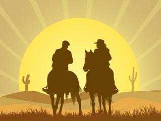 couple on horseback in the desert