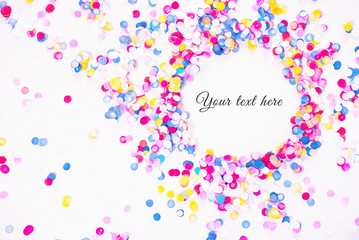 Colorful confetti on white background with sample text