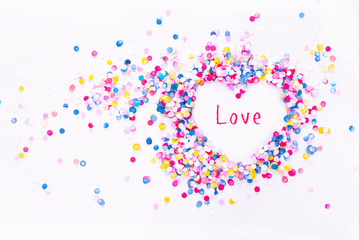 Heart shape in confetti with sample text, love