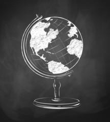 Globe drawn on chalkboard.