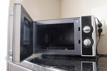 Empty microwave oven with open door