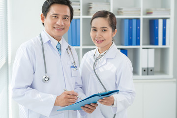 Asian doctors with medical document