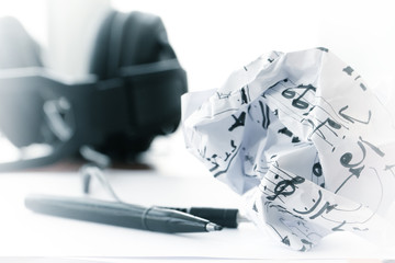 composing music concept with shallow DOF evenly matched crumpled