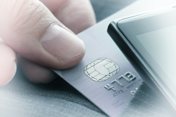 Credit cards in very shallow focus with gray suit background as