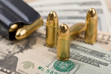 bullet on US dollar banknotes