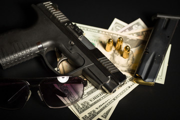 gun with bullet on US dollar banknotes