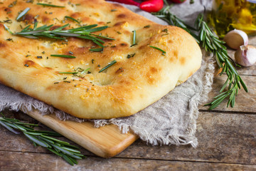 Italian focaccia bread with rosemary and garlic