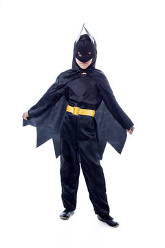 Studio shot of cute boy dressed as Batman