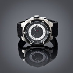 Swiss watches on gray vignette background. Product photography.