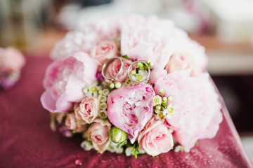 Wedding rings on a bouquet of colorful flowers