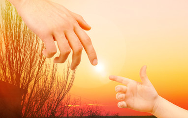 Child and father hands on nature background