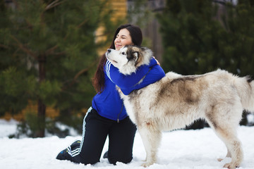 Woman with malamutes
