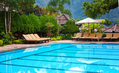 pool with blue water in a recreation area of hotel in tropics