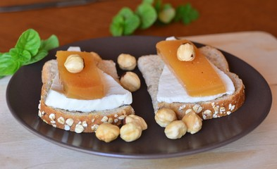Quince And Fresh White Cheese On Bread Toast