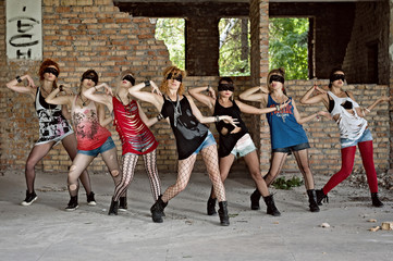 Dance group on industrial background