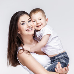 happy mother with a child on light grey background