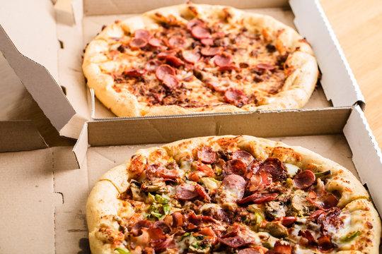 Homemade pepperoni pizza in carton box