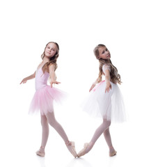 Two pretty girlfriends-ballerinas posing at camera