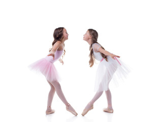 Amusing ballerinas posing looking at each other