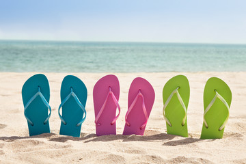 Pairs Of Flip-flops On Beach