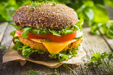 Healthy fast food. Rye burgers with fresh vegetables, chickpeas