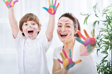 Child painting with mum