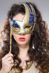 Girl with Venetian mask