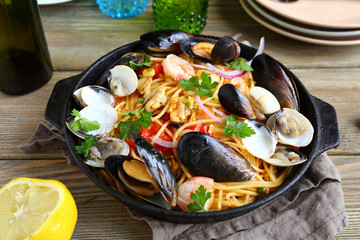 Pasta with seafood and lemon in a frying pan