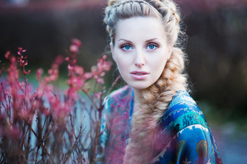 A beautiful blond haired blue eyed young woman