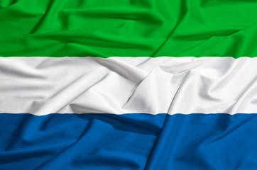 Sierra Leone flag on a silk drape waving