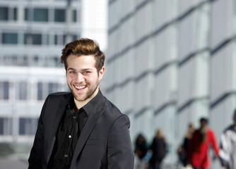 Cool guy smiling in black business suit