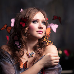 The woman with butterflies in hair