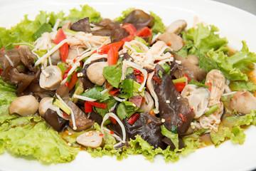 Spicy mushroom salad on plate