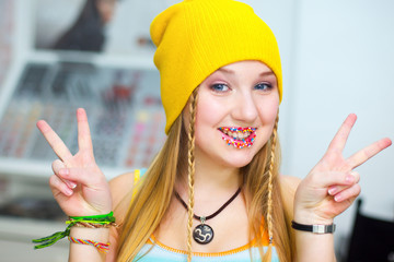 Happy smiling  Hippie with candies on lips