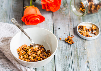 homemade granola with nuts and dried fruit, honey, flowers