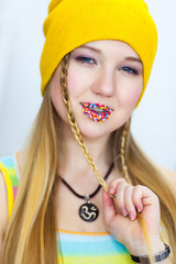 Creative bright make-up with easter sweets