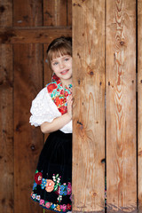 Posing baby girl in traditional costume