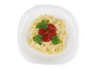 Pasta in white glass plate with tomato ketchup and parsley