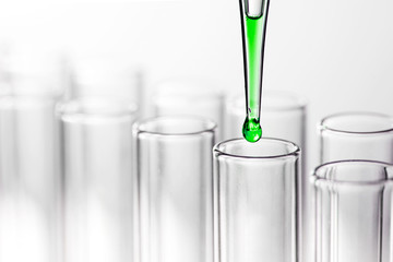 Pipette with drop of liquid