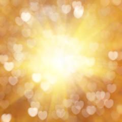 Golden heart symbol texture bokeh
