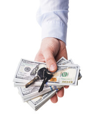 The isolated hundred dollar and keys in a hand - Stock Image