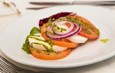 Caprese Salad with Onion and Pesto