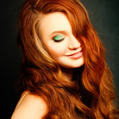 Long Curly Red Hair. Fashion Woman Portrait. Beauty Model Girl