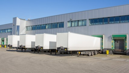 Distribution centre with trailers waiting to be loaded